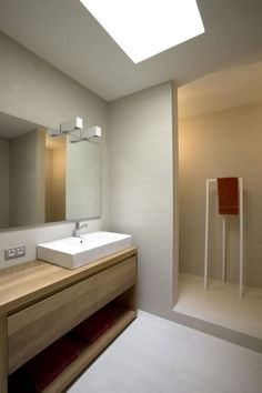 Attractive Bathroom With White Sink And Wooden Vanity Under The Bright Light In The Home And Wine Cellar #grey sofa, #architecture. wooden window stutter, #oak flooring