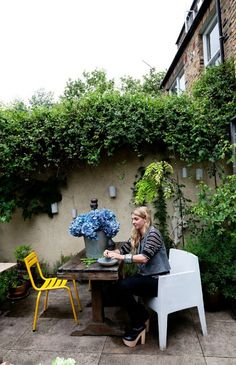 Paved yard with potted plants - Abigail Ahern
