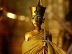 beautiful gold King Tutankhamun statue from ancient Egypt