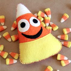Who doesn't love candy corn? These little guys make great Halloween or Thanksgiving decorations or a fun toy! (free pattern & tutorial)