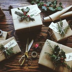 Brown paper wrapped gifts, deorated with greenery and sprinkled in 'snow' spray paint.