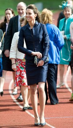 Kate Middleton Style: Looking beautiful in blue, Kate wore a navy jacket and skirt combo.