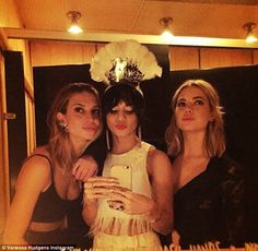 Bathroom beauties: She snapped a selfie with her Spring Breakers co-star Ashley Benson and...