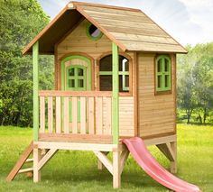 Freeport Park This medium-sized playhouse is equipped with a floor on a low substructure and includes a small ladder as well as a slide. Many hours of fun are guaranteed! Wood Playhouse, Kids Playhouse Plans, Playhouse Outdoor, Kids Wooden House, Garden Play Equipment, Luxury Playhouses, Backyard Playground, Backyard Garden Design, Building A Shed