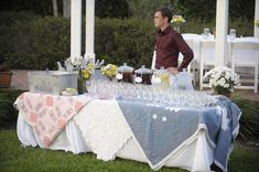 ...Picnic Wedding Lemonade and Tea Stand for a homey country wedding..... quilts for drinks table instead of lace
