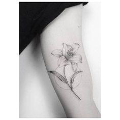 Fine line lily tattoo on the left inner arm. Tattoo artist: Jakub Nowicz