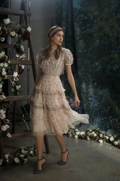 The ultimate party dress for the new season. The Victorian-inspired Jet Frill Dress in pink is crafted in frothy tulle and finished with delicate beading. Glassy buttons adorn the textured bodice of this embellished midi dress, and a nude camisole keeps it ultra wearable.