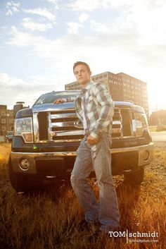 Truck and a cute boy... what more can someone ask for?