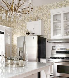 Gold and silver damask Thibault wallpaper in a kitchen.