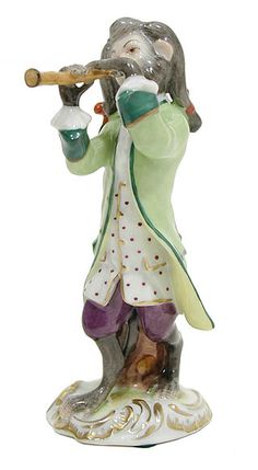 Monkey Musician (21st century), figurine, Meissen porcelain, Aelteste Volkstedter (contemporary) Ref. Website: The Best Things (2007 – col.) A standing monkey plays a pipe which may be a duct-flute, possibly a recorder.
