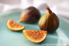 Luscious sweet Figs are made even sweeter by a drop of golden honey.  http://proofpositiveimaging.photoshelter.com/gallery-image/Food/G0000vxWBxmMXSBY/I0000upNhsjVGxPc/C00004tzArDrbjNQ  © Jennifer Hill, Proof Positive Imaging Photographer Jen Hill