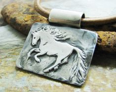 Just...a...little...closer... One friend reaching out to another. Two beautiful horses in fine silver. Each link begins with my handmade template, then receives additional detail and sculpting. No two are exactly alike, but are extremely similar. If youd like to see the exact bracelet you would receive, just let me know and Ill send you a photo. Or you might choose to wait until it arrives to see the unique and beautiful personalities that adorn your wrist. A bit like expecting a foal, but…