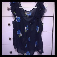 Floral sheer top Very pretty see through Hollister floral shirt with a small bow near the neck Hollister Tops Blouses