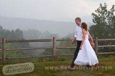 bride and groom get wet after the mountain ceremony, Homan Designs Photography, Charlotte wedding photographer, Huntersville, N.C.,   www.homandesigns.com