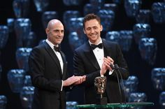 VERY DAPPER INDEED! Mark Strong stars in the Young Vic transfer of Arthur Miller's #AViewFromTheBridge at Wyndhams Theatre ♡ Pictured here at the 2015 BAFTAs alongside Tom Hiddleston: www.LOVEtheatre.com/tickets/4095/A-View-From-The-Bridge?sid=PIN
