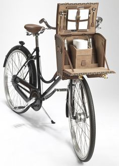 Who needs a whicker basket when you can have a picnic basket instead? Moynat Bicycle Trunk.  Great for traveling the trails.