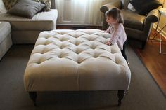 Amazing White Tufted Ottoman Coffee Table With 4 Black Wooden Base Leg And Sweet Brown Single Couch And White Fabric Living Sofas In Modern Living Room With Kid For Inspiring Decor Living Room Ideas Tuffed Ottoman, Leather Ottoman Coffee Table, Diy Ottoman, Large Ottoman, Ottoman Table, Fabric Ottoman, Modern Ottoman, Homemade Ottoman, Diy Footstool