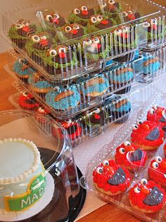 """Actual """"how to"""" for decorating the cupcakes and smash cake.  I just went to the bakery and had them ice the different colors on there, then I used a spatula to make the characters """"furry"""" by pulling away at the icing to make it spikey. Saved a ton of time!"""