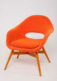 Czech mid century modern. I adore the style and the wonderful cheery orange colour.