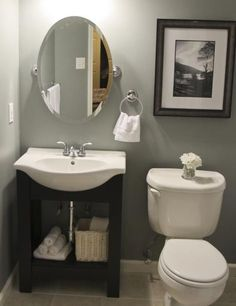 Small bathroom idea.  I like the color.