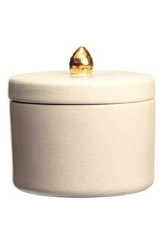 Stoneware box: Trinket box in stoneware with a crackled finish. Matching lid with a gold-coloured knob. Height 14 cm, diameter 10 cm.