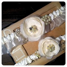 Bridal Heirloom Garter set Ivory Cream with Pearls, Crystals and Rhinestones Customize-able to match you Wedding colors. $48.95, via Etsy.