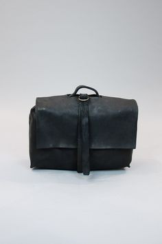 simple raw leather bag