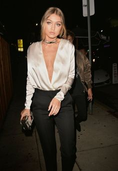 Gigi Hadid looked so gorgeous in a low-cut satin top, black pants, and a choker.
