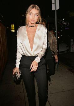 Gigi Hadid's Plunging Neck Satin top, Black pants & a choker.