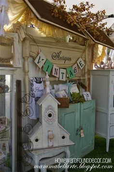 Vintage wood window screens become an 'awning' in a booth display at The Vintage Marketplace at the Oaks show (Rainbow, CA). Shared on HOMEWARDfound Decor: Farmhouse Fall