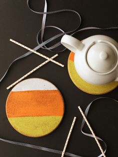 If you have some extra cork rounds in your house, use craft paint to add a cute candy-corn theme.