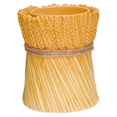 Celebrate the abundance of fall with Grateful Harvest, an enduring symbol of a rich and plentiful season. Hand-painted in earthy tan and gold with a jute �tie,� this porcelain warmer glows when lit. It is the perfect fall accent for any room!