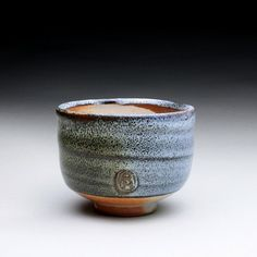 This stoneware yunomi's surface glaze is a combination of iron stain and a wood ash glaze. -- Ray Morales