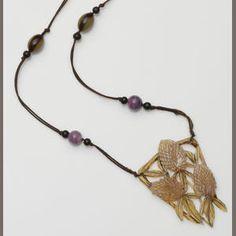 An Art Nouveau stained horn pendant, by Elizabeth Bonté
