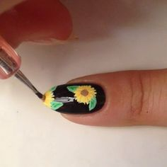 Sunflower tutorial!  1⃣ Paint your nails black and add a top coat. Adding top coat to your base always allows for a smoother design when using acrylic paints. I also mix my acrylic paints with a little water before I draw so they're thinner and smoother. 2⃣ Draw your flowers in white first (you can skip this step if you decide to use a lighter base. White just helps the color pop more on the black). Start by drawing the lines as shown, then filling the spaces in with thin lines. 3⃣ Color