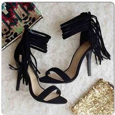 """⭐️SIZES 5-7⭐️NIB Black Ankle Fringe Heels NIB Black Ankle Fringe Heels. These fun heels dress up any outfit! Gathered ankle fringe detail with gold zipper closure in back. 4 inch heel. Padded footbed for comfort. Ankle strap is about 9-10"""" around. True to size. Available in 5, 6, 6.5, 7No Trades and No PaypalSold out of 5.5, 7.5, 8, 8.5, 9, 10 Shoes Heels"""