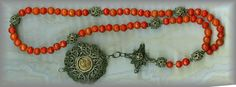 Rare, faceted antique Rosary with coral Aves and Filigree Paters. Coral was believed to have healing properties and was very popular as a rosary bead. (note the paintings of the early centuries.) Rothenberg- pre 1850s.