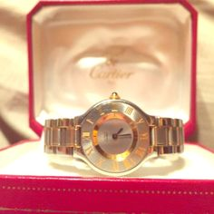 """Gorgeous Authentic Cartier Watch Gorgeous Authentic Cartier 18 kt gold and Satinless Steel watch in a size 5.5"""". This watch cones with the box, a new battery, and paper work. To have add extra links added it can me done for the low price of $50 a link at Mayors Jewelry Store and this can be confirmed with a simple phone call. Dont miss out on having a extravagant piece of jewelry for a fraction of the cost. All REASONABLE offers Considered. Cartier Accessories Watches"""
