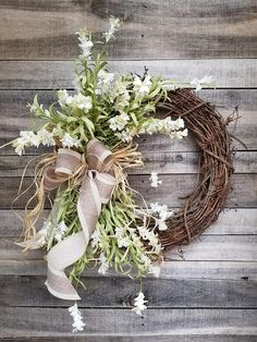 This beautiful Cream floral wreath is the perfect simple accent for your door or interior. A wired burlap ribbon makes a simple bow. Perfect for a summer outdoor wedding Average Diameter: 22 (tip to tip) This wreath will be created on a grapevine wreath measuring approximately 18