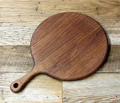 READY TO SHIP! This cutting board is made from walnut. Sanded and finished to a silky smooth touch. The whole board is completely rounded on the edges, and it sports a small hole for hanging/display. Finished with mineral oil, initially, then rewaxed/buffed with mineral oil/beeswax at