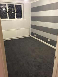 Getting there! Pebble walls with Slate and Warm Grey painted striped feature wall