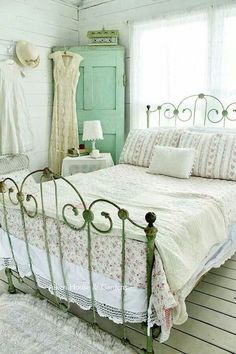 Love the painted wood walls and the bed.