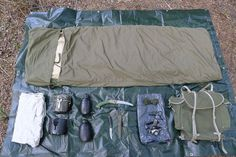 Budget Bushcraft Kit : Sleeping system (Czech Army), Sleeping Mat (Ex-British Army – issued), Sleeping Bag Liner, Swedish Army Trangia Stove with Danish Pan set, British Army 1l water bottle x2, Highlander Folding Saw, Mora Clipper Sheath Knife, 100' 550 Paracord, 'Wildo' small cadet Fire Flash, LED Head Torch (ebay), Bin bag rucksack liner, Metal Spoon, Norwegian Army Vintage Canvas 'Telemark' Rucksack, Green Heavy Duty Plastic Tarp. Total spend 99.88£.