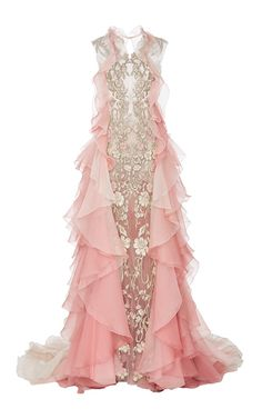 This **Marchesa** gown features floral threadwork and cascading organza layers.