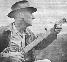 """Frank Proffitt, of Reese, North Carolina, with his homemade fretless banjo. He taught """"Tom Dooley"""" to Frank Warner of New York City, who taught it to the rest of us. He also makes a limited number of this homemade style, for sale. -- SOURCE: """"How To Play the 5-String Banjo"""" by Pete Seeger (3rd edition, 1961)"""