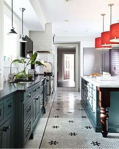 kitchen with inky green base cabinets, white walls and hex pattern tile floor