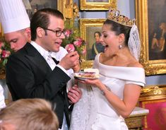 Crown Princess Victoria of Sweden and Prince Daniel, Duke of Vastergotland share a slice of wedding cake during the Wedding Banquet at the Royal Palace on June 19, 2010 in Stockholm, Sweden.  Princess Victoria Gold Tiara