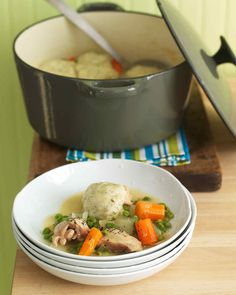 Chicken and Dumplings | Martha Stewart Living - Steam dill-flecked dumplings over a stew of chicken thighs, carrots, and peas. No need to spend all day in the kitchen -- this down-home favorite is ready in an hour.