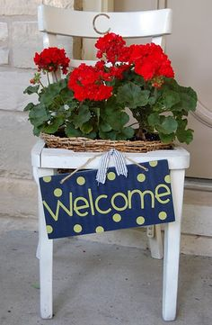 welcome chair planter- my front doorstep is actually big enough for this. Outdoor Projects, Garden Projects, Outdoor Decor, Garden Chairs, Garden Planters, Chair Planter, Red Geraniums, Painted Chairs, Porch Decorating