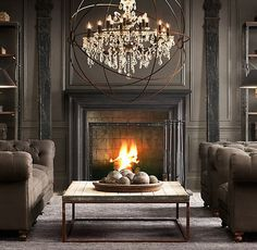This room is all about that chandelier! Gorgeous Deep Rich colors in this Living Room. Fireplace is warm & inviting. Furnishings from Restoration Hardware. Design Furniture, Garden Furniture, Foyers, Style At Home, Home Design, Design Ideas, Great Rooms, Interior Inspiration, Home And Living